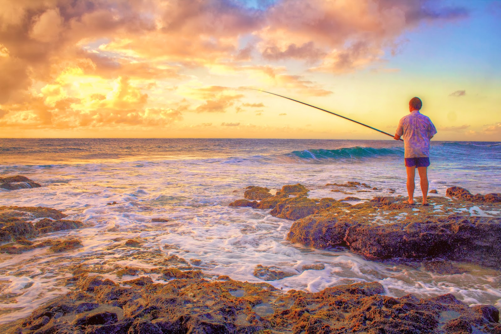 Fisherman shorecasting off the Ka Iwi Coastline, O'ahu