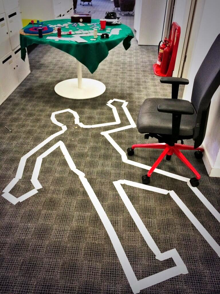 Crime Scene in the Office - White tape stuck on the floor forming the edges of a dead body