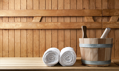 The interior of a sauna to demonstrate the health benefits of a sauna.