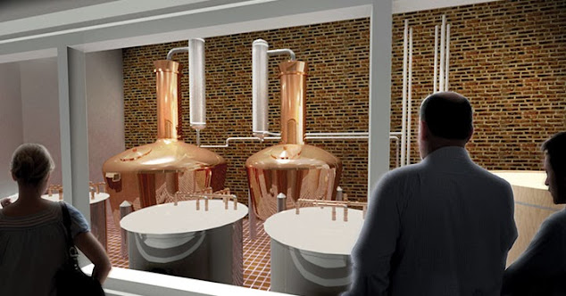 room with brick walls and two copper stills and guests on a tour in the foreground