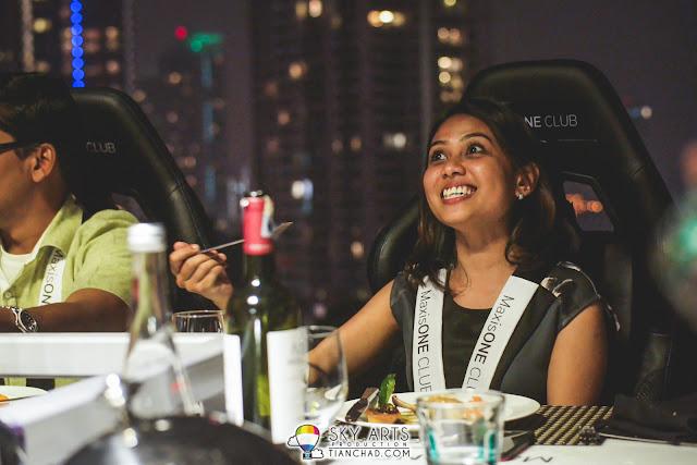 Happy guest having dinner in the sky