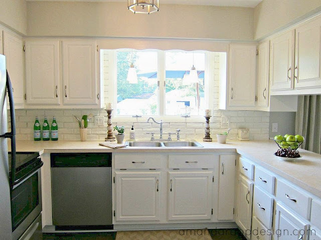white brick backsplash, white cabinets, stainless appliances. Visit amandarappdesign.com for the Before & After!