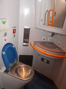 """A view of """"Leo Express"""" train toilet."""
