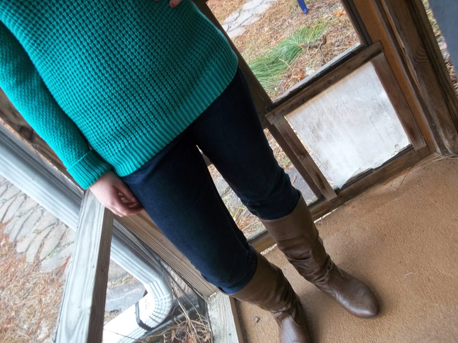 Casual Holiday Style. Green sweater, jeans, brown boots, statement necklace.