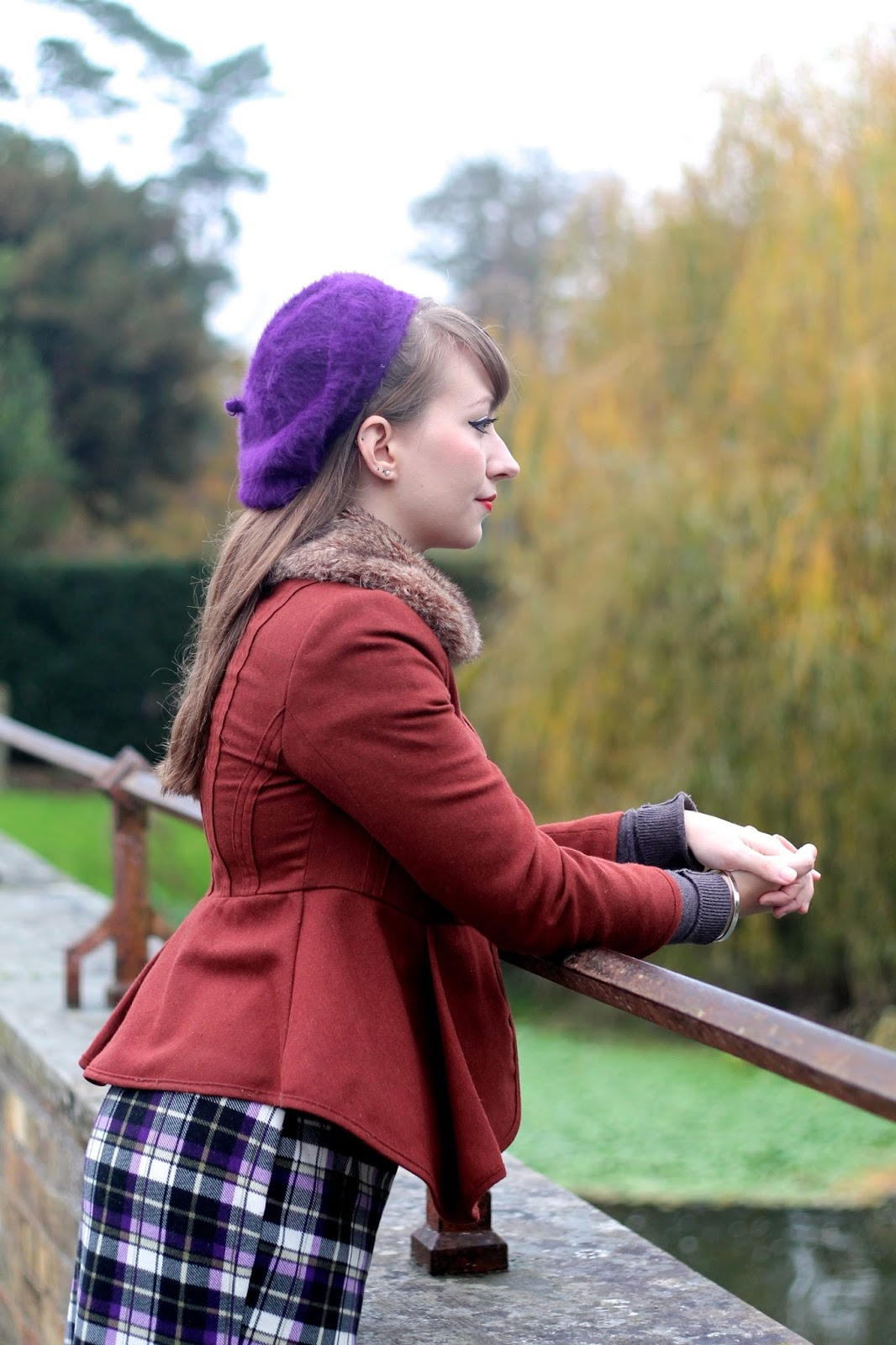 Tan jacket with purple beret