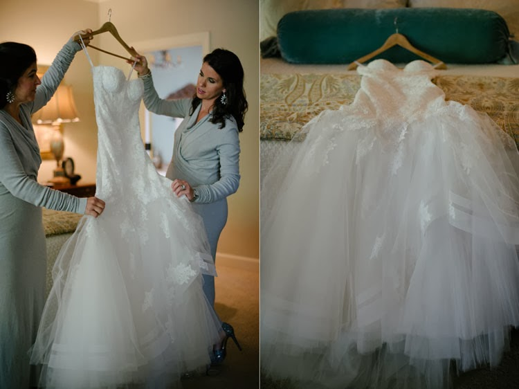 Monique Lhuillier wedding dress being held by two bridesmaids