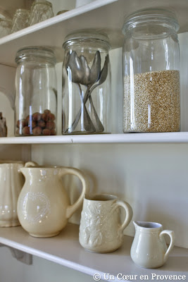 Old glass jars on the kitchen shelves