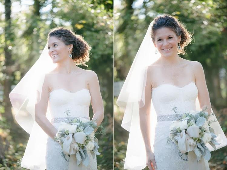 happy bride glancing over her shoulder holding her bouquet