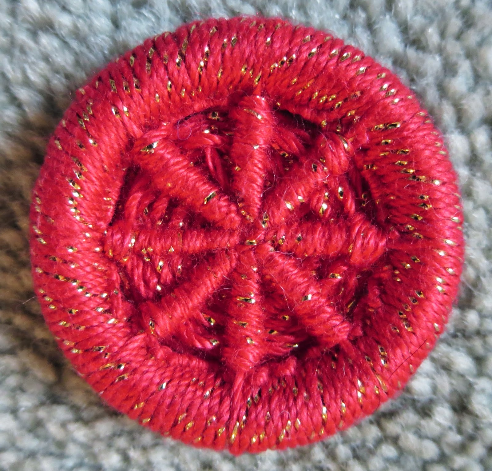 Red dorset crosswheel button