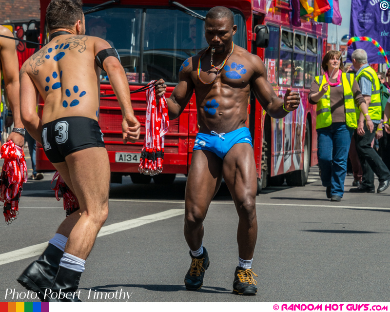 Muscular black guy dancing in gay pride parade