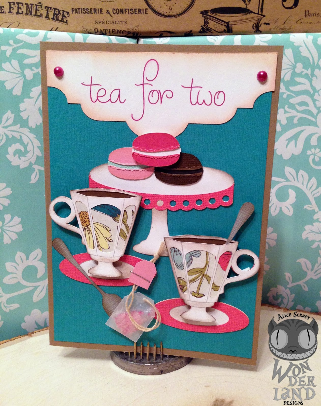 i started with a kraft card and a teal background i then used my silhouette sketch pen in a glittery pink to write out tea for two and cut it out as