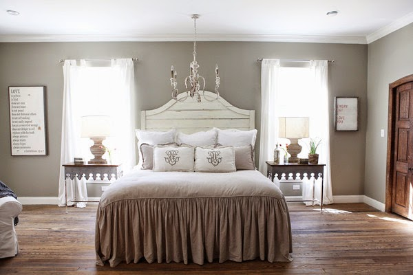 Love the scalloped zinc side tables and waterfall bedding here it