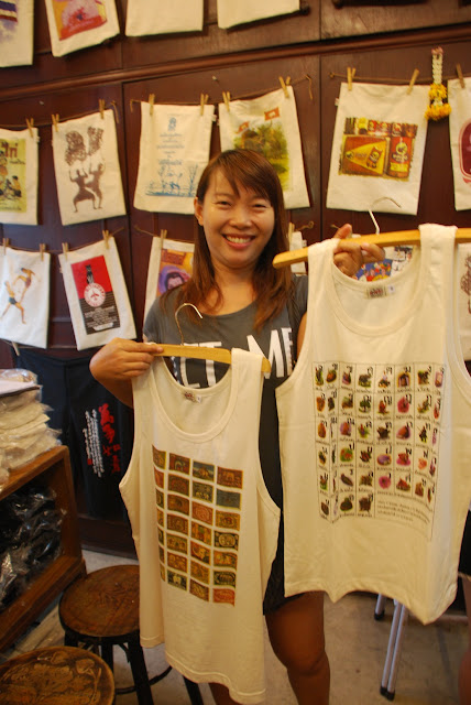 Aui - owner of One of Us vintage t-shirts in Bangkok's Chatuchak Market