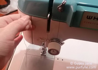 correct threading of the upper thread in a sewing machine