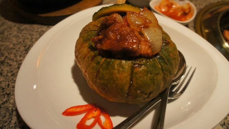 Baked pumpkin with sweet and sour chicken