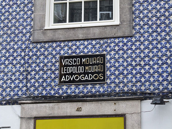 azulejo building porto portugal blue