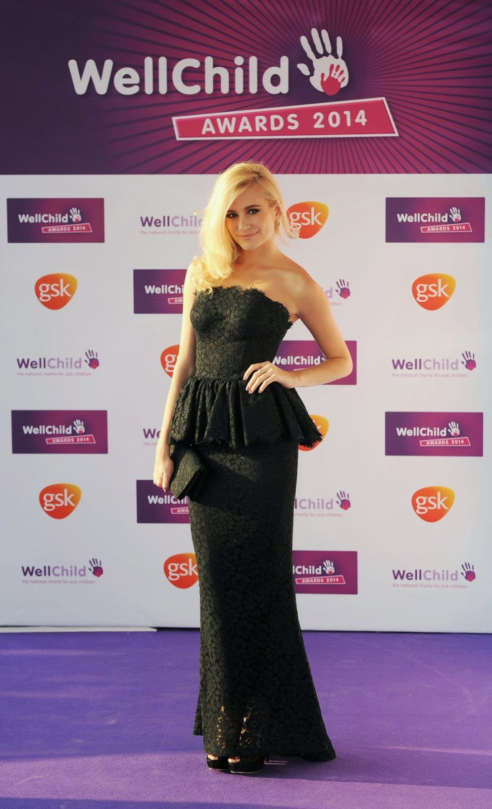 Pixie Lott flaunts a strapless black lace dress at the 2014 WellChild Awards in London