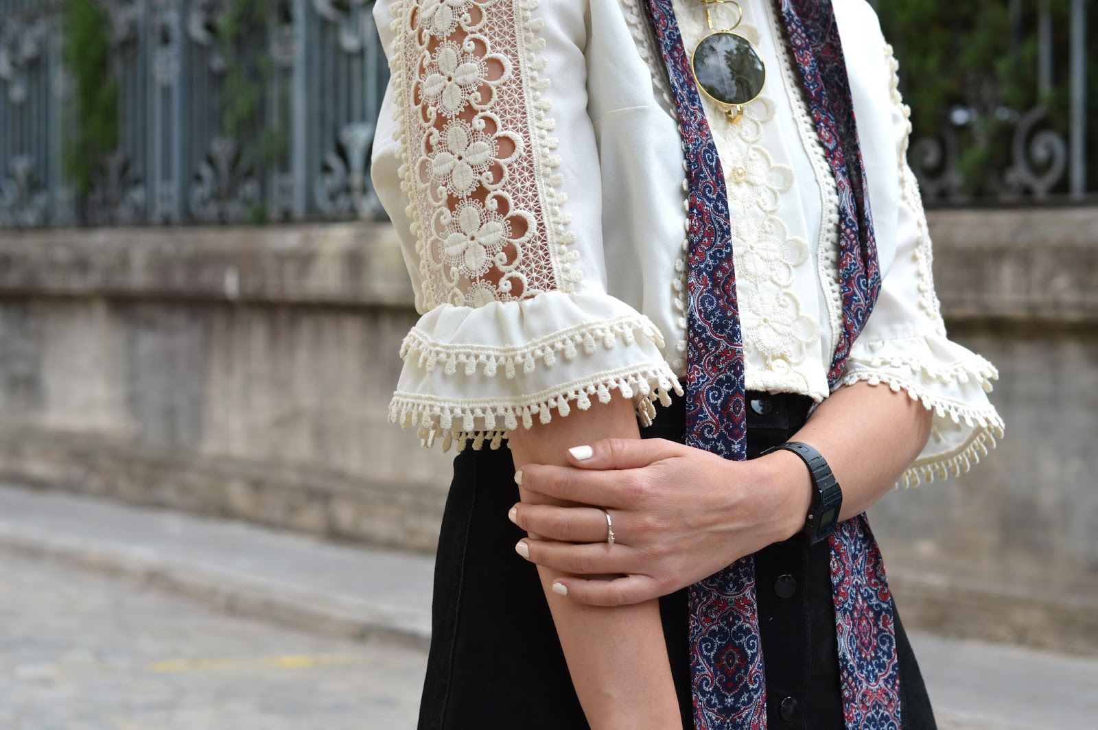 Lace detailing on cream blouse