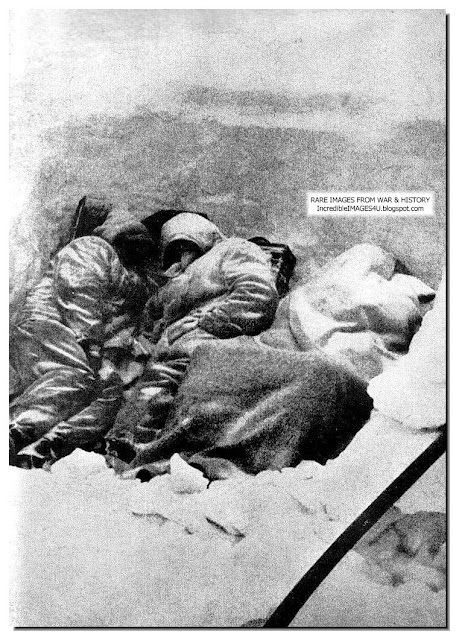 Dead german soldiers in a foxhole. frozen to death in the bitter
