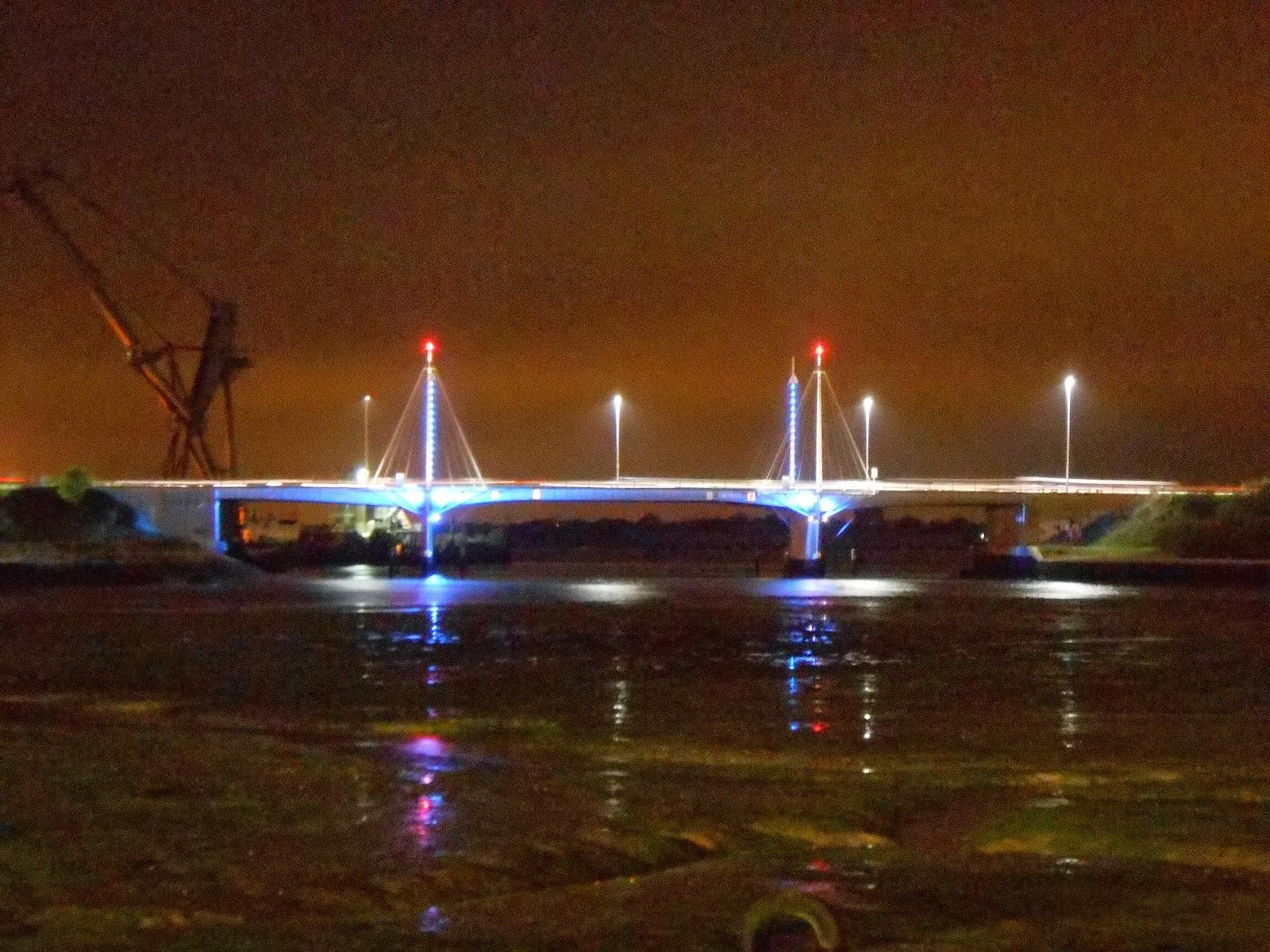 sky glow over portsmouth tipner lake and motorway bridge