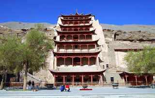 Mogao Caves, the most famous attraction in Dunhuang, visiting it by your China travel tour.