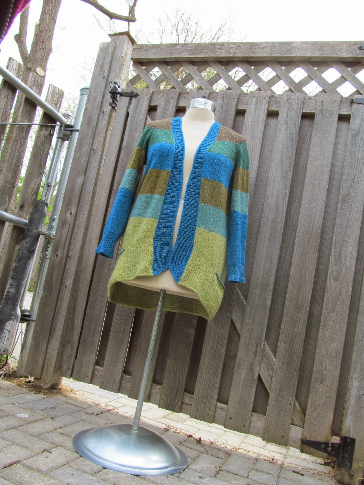 http://www.ravelry.com/patterns/library/bluesand-cardigan