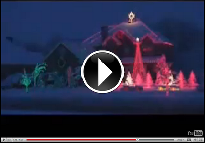 image of video for a Christmas holiday light show. House is decorated with lights and is animated to music