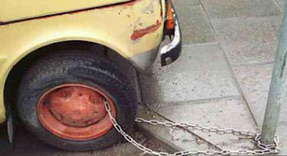 Funny picture: car locked with chain