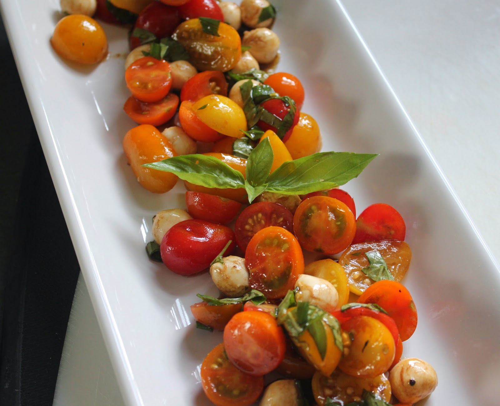 Caprese salad with tomatoes and basil from the garden
