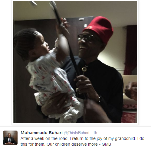 Photo of Buhari Having Fun With Grandchild After a Week on the Road