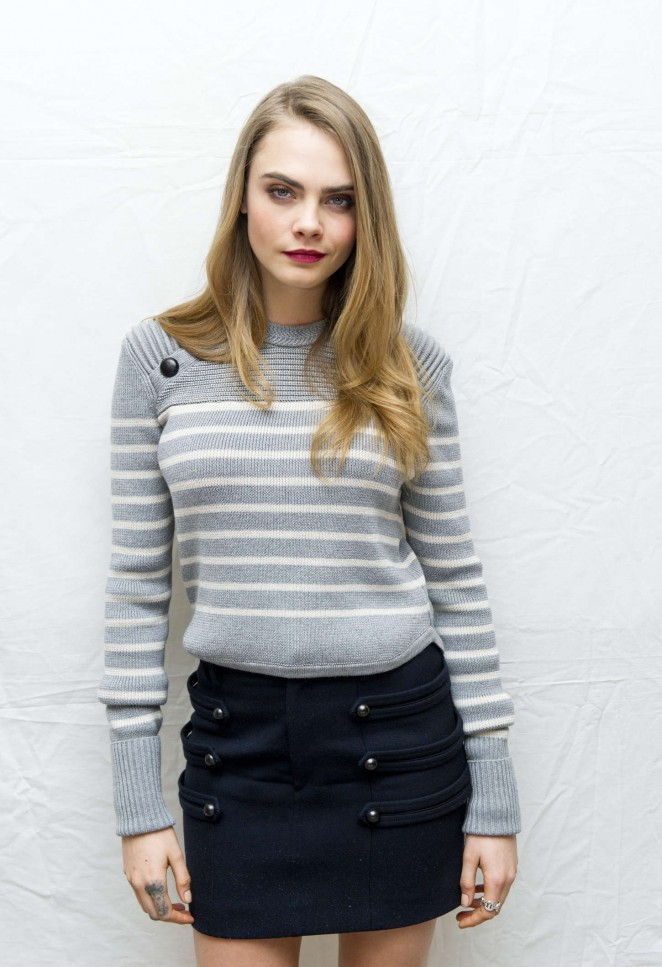 Cara Delevingne in a military inspired mini skirt at the 'Paper Towns' Press Conference in West Hollywood
