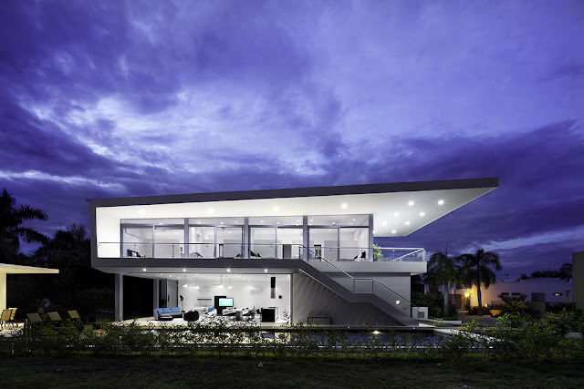 Side view of modern home at dusk