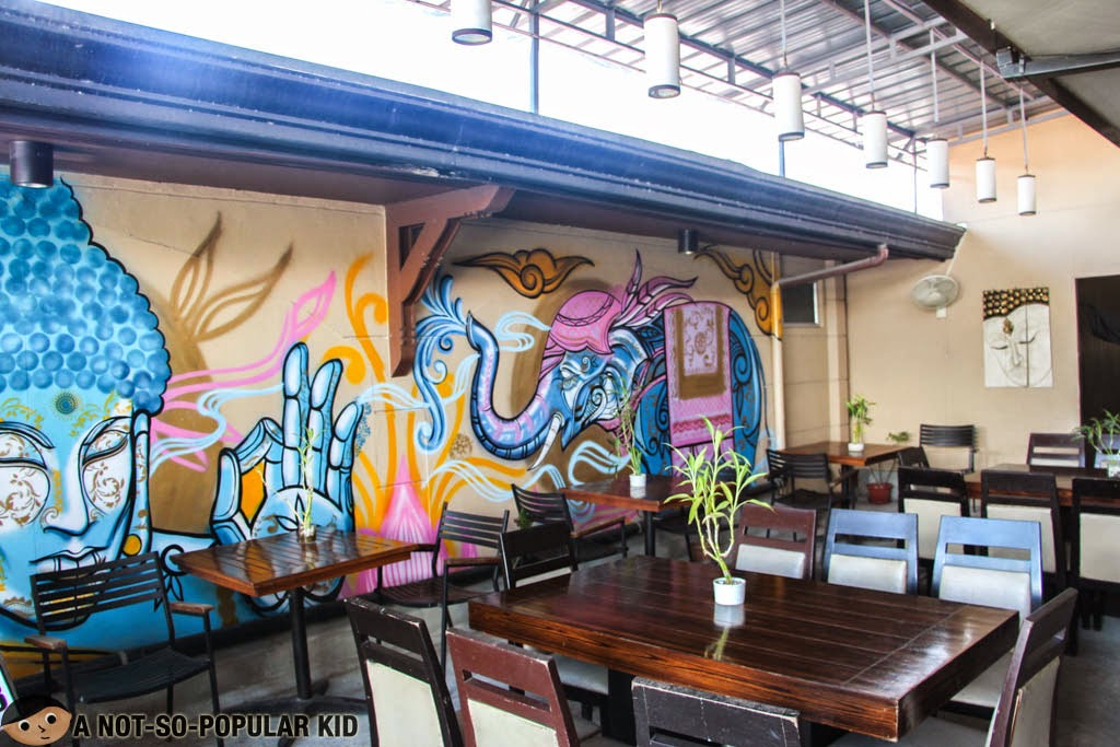 Thai mural art in outdoor area of Songkran - Authentic Thai Street Food
