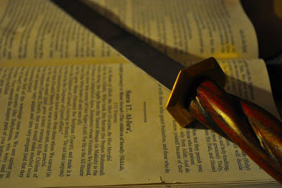 sword on old book