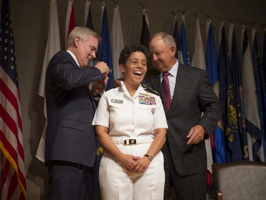 Husband Of Adm Michelle Howard Put Four Star Shoulder Boards On US Navy Photo By Chief Mass Communication Specialist