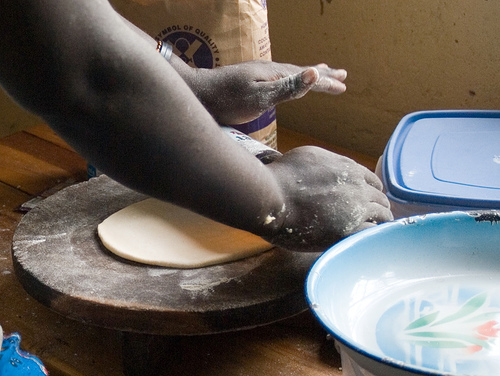 Making chapatis in Uganda.