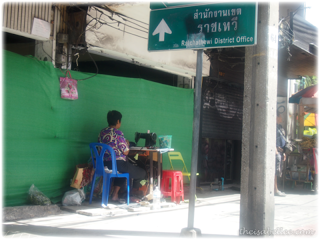 Woman sewing clothes in Bangkok