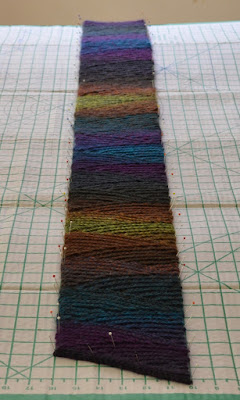 Long view of 'Shadow Spectrum' slip stitch scarf on the blocking board.