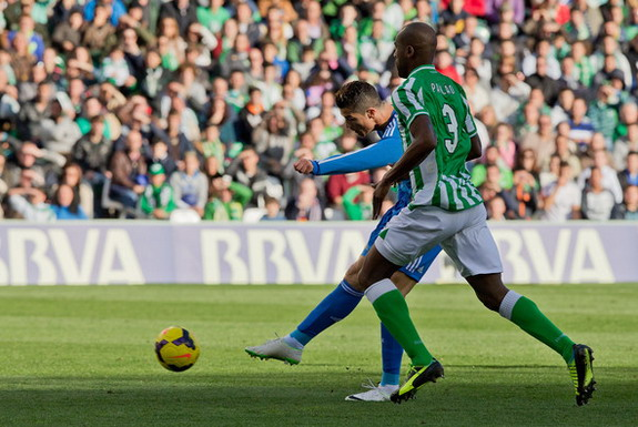 Real Madrid player Cristiano Ronaldo shoots to score his team's opening goal against Real Betis