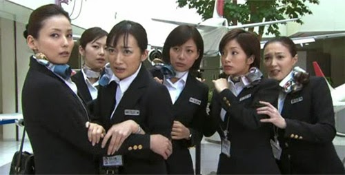 Hirota and Higashino cling to the other cabin attendants.