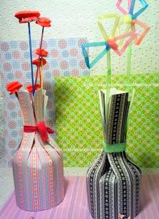 http://clarabelen.com/inspiraciones/5863/jarrones-faciles-de-papel-para-hacer-centros-de-mesa-con-los-ninos/
