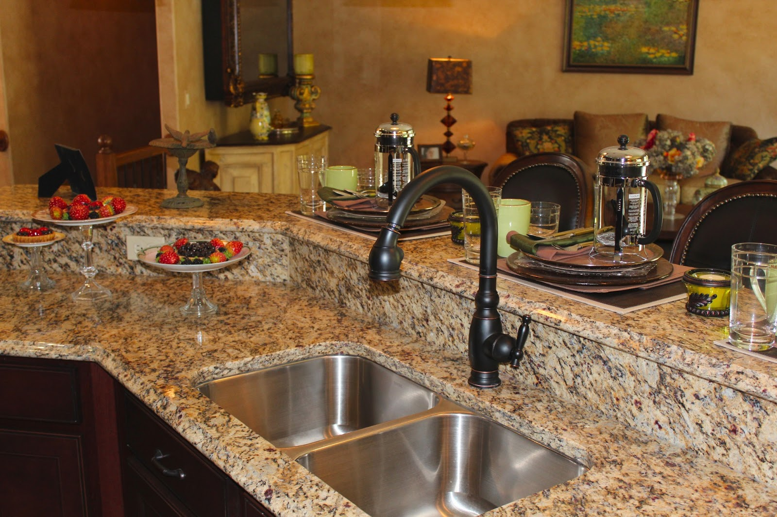 Kitchen countertops benefits of granite quartz and corian for Who makes quartz countertops