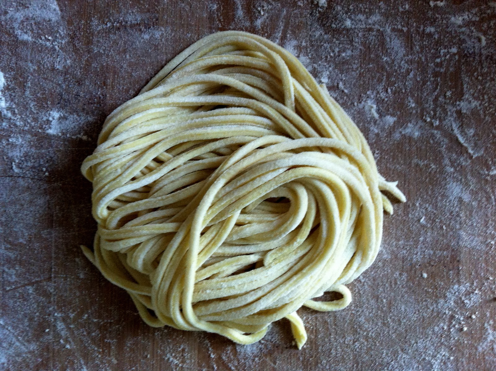 Freshly cut vegan pasta dough, out of the pasta maker and ready to ...