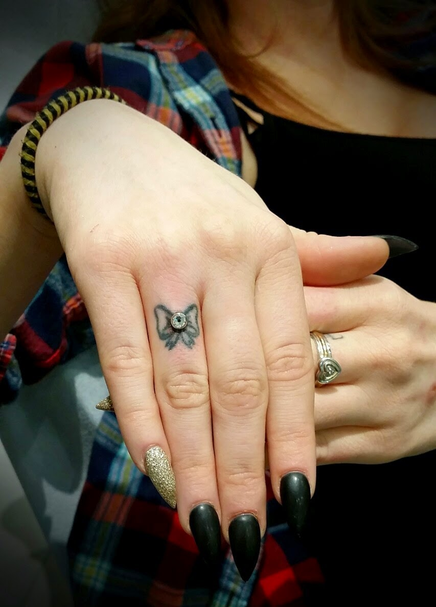 Cute bow finger tattoo designs and ideas dashingamrit for Finger tattoos for girls