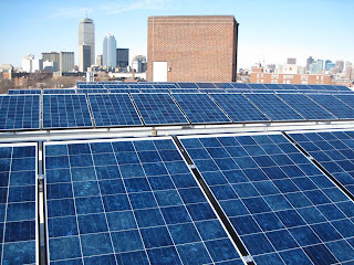 Roof mounted solar photovoltaic array with Boston Skyline