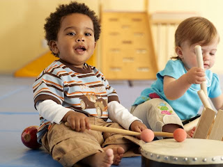 Toddler Playing Music Instrument