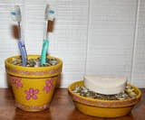 http://familycrafts.about.com/od/claypotcrafts/a/ClayPotBathroomSet.htm