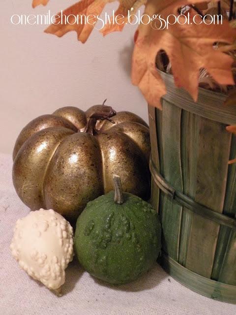 Gold pumpkin and green basket fall decor