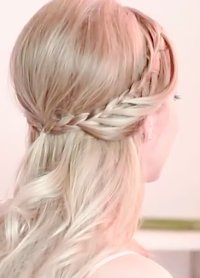 Half up half down hairstyle with lace waterfall braid