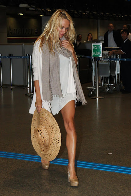 957439493 pm1 122 405lo Pamela Anderson Arriving at Sao Paulo Airport in Brazil [July 27, 2011 ]